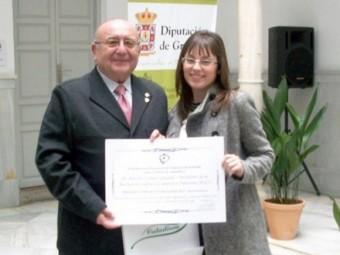 El presidente de la ALCI y la gerente, en un reciente acto celebrado en Granada
